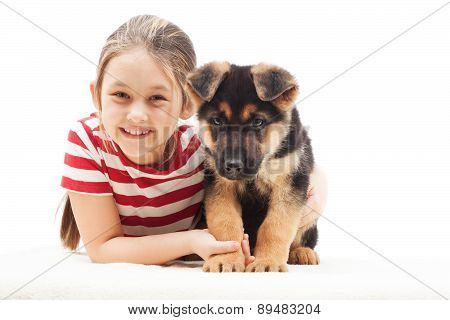Little Girl And Puppy Shepherd Dog
