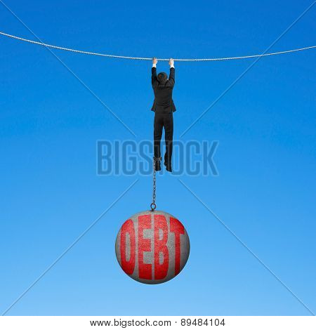 Businessman Shackled By Debt Ball Hanging On Rope Blue Background