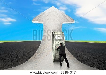Businessman Pushing Money Circle On Arrow Marble Road With Sky