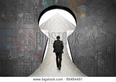 Businessman Walking On Marble Road Toward Keyhole Door With Doodles