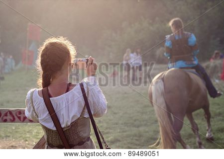 Girl Is Taking A Photo At Tustan' Festival In Urych, Ukraine, August 2, 2014