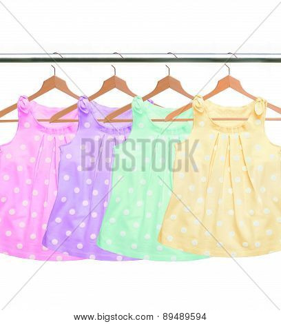 Different Clothes On Hangers Isolated On White Background