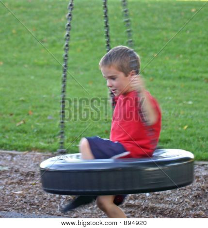 Boy On Tire Swing Dizzy