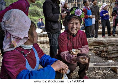 Asian Woman With Rose Hairstyle Smiles On Rural Holiday, China.
