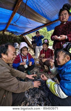 Rural Chinese Farmers Talk Around Campfire At  Village Festival.