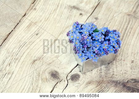 Heart Shape With Forget-me-not Flowers On  Rustic Wood