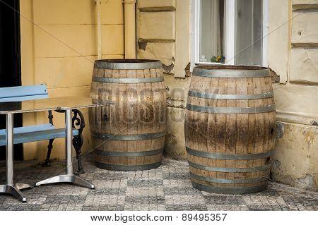 Barrels standing on street.