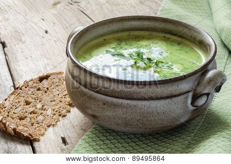 Green Soup With Broccoli, Arugula And Spinach In A Ceramic Bowl On A Rustic Wooden Board