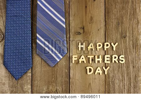 Happy Fathers Day letters with ties on rustic wood