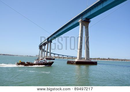 Boat crossing Coronado Bridge