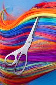 foto of wig  - scissors with color wig on a blue background - JPG