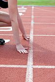 Close-up Of A Woman Waiting In Starting Block