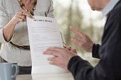 picture of divorce-papers  - Elderly woman demanding divorce form her husband - JPG