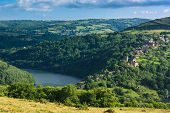 pic of dam  - Landscape with hill and medieval houses around lake Lac de Castelnau - JPG