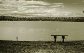 foto of wilder  - One park bench on the shore of a remote wilderness lake - JPG