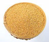 foto of mustard seeds  - yellow mustard seeds in wooden  - JPG