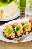 stock photo of crust  - Meat and Tomato Stuffed Eggplant Halves with Cheese Crust selective focus on the middle eggplant crust copy space for your text - JPG