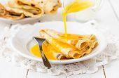 stock photo of crepes  - Thin Pancakes with Orange Sauce  - JPG
