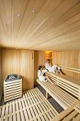 stock photo of sauna woman  - Young women relaxing on the bench in sauna - JPG