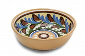 foto of ceramic bowl  - Ceramic bowl with floral ornaments on a light background - JPG