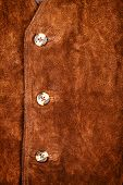 foto of vest  - Fragment of brown suede vest with buttons - JPG