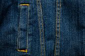 picture of denim jeans  - Worn dirty blue denim jeans texture with a pocket - JPG