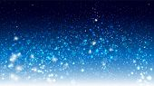 picture of glowing  - Magic glow and bokeh on a blue background - JPG
