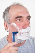 image of shaved head  - Man shaves his face - JPG