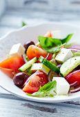 stock photo of kalamata olives  - Bowl of colorful summer salad with feta and olives - JPG