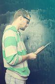 foto of nerds  - Good Looking Young Nerd Smart Guy Man Using Tablet Computer - JPG