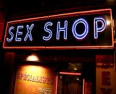 stock photo of porno  - sex shop neon sign over entrance - JPG