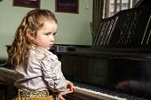 picture of grand piano  - Cute little girl playing grand piano in music school childhood concept - JPG