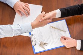 picture of handshake  - Top view of handshake of a real estate agent and a client - JPG