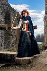 pic of bow arrow  - Ancient female archer with bow and arrow - JPG