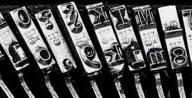 image of groping  - types and character of an old typewriter - JPG
