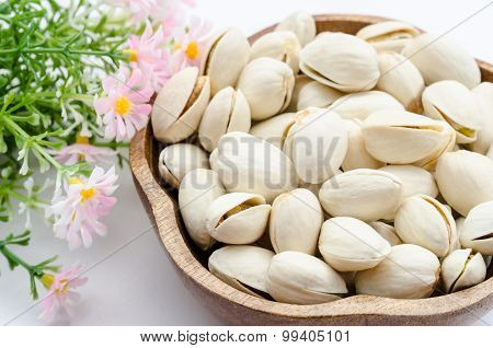 Pistachios Nuts In A Wooden Bowl