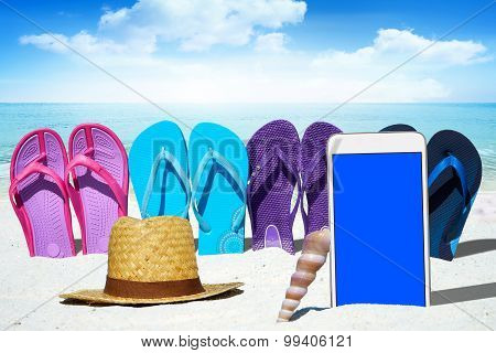 White Smartphone And Straw Hat