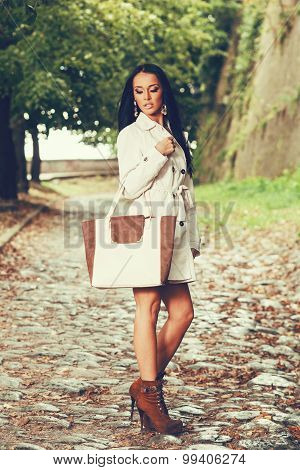 Attractive Young Woman Posing With A Bag In Hand
