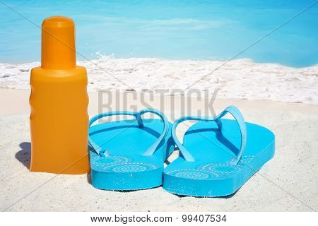 Flip Flops And Suntan Lotion
