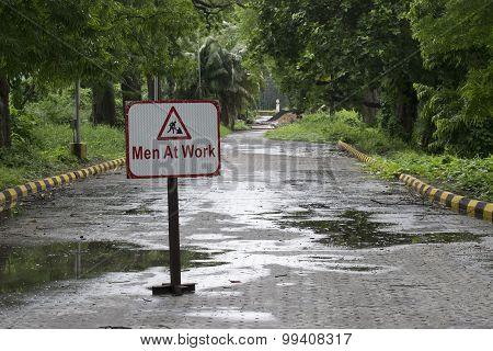 Men At Work Symbol On Roadside In A Park