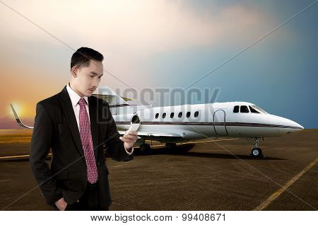 Young Business Man Calling By Phone When Walking To The Plane