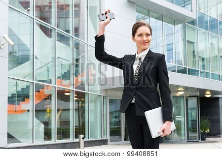 Young business woman waving hand
