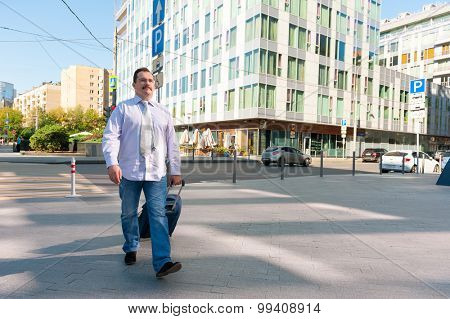 Middle age businessman walking on a city street