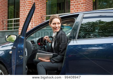 Young business woman in a car portrait