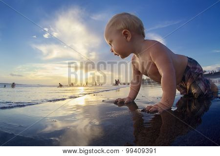 Little Child On Sunset Tropical Beach