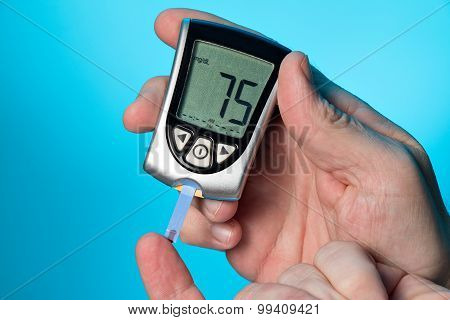 Blood Glucose Meter To Check The Blood Sugar Level