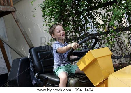 Boy Driving A Tractor