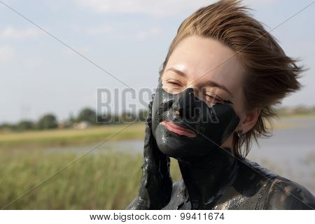 Woman Applying Mud