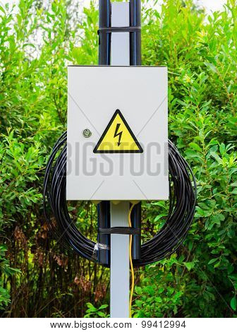 Electric box with wires on pole