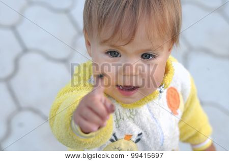 Little Girl Looking Up On The Finger